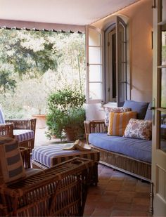 Michael S. Smith arranged a casual mix of vintage wicker covered in periwinkel on the veranda a Portuguese-style quinta in Montecio, California. Photo by Lisa Romerein. Outdoor Rooms, Outdoor Living, Outdoor Furniture Sets, Outdoor Decor, Rattan Furniture, Outdoor Seating, Porches, Pergola Shade, Beautiful Interiors