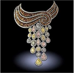 I love the elegant drape and swirl of this necklace.