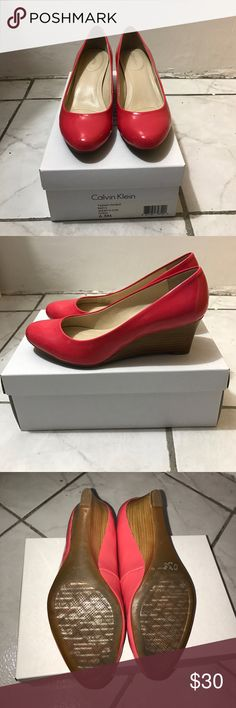 Calvin Klein wedge heels Calvin Klein wedge heels. Color is coral. Patent. Size 6.5. Worn a few times. There is a scuffed area to the right front part of the shoe as shown on the last picture. Comfortable wedge heels. Calvin Klein Shoes Wedges