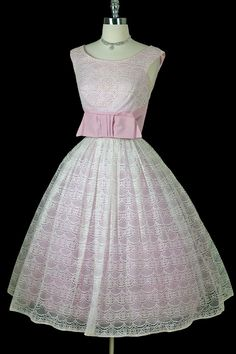 1950's dress-I don't know what I think of the bow in front, but aside from that, this dress is a dream!