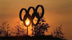 In just a few days' time the Olympic Park will welcome millions of people through its gates. In this shot the sun sets over a set of giant Olympic Rings on the Park.