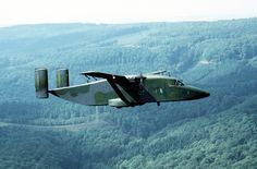 Towards the end of the 'Cold War', 10th MAS Short C-23A Sherpa 84-0458, named 'Sembach', flies over a European forest. The aircraft was retired in December 1997.