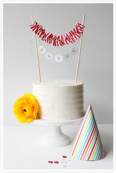 Ignore ugly rufflese - Banners on Cakes. Too cute.