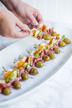 Antipasto Skewers & Party appetizers, entertaining ideas, party ideas, party recipes and more from Cyd Converse & The Sweetest Occasion Quick And Easy Appetizers, Finger Food Appetizers, Easy Appetizer Recipes, Yummy Appetizers, Appetizers For Party, Appetizer Skewers, Antipasto Recipes, Salami Appetizer, Easy Finger Food