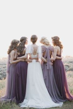 bridesmaids gowns in different hues of purple