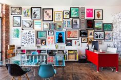 Wall covered in colorful framed posters