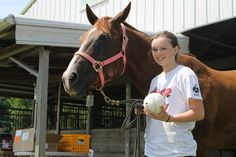 Bailey Martin, 14, of Hubbard, poses with her horse Annie and one of the beep baseballs she will be playing with next week at the National Beep Baseball Association World Series in Ames. Photo by Grayson Schmidt/Ames Tribune http://www.amestrib.com/news/hubbard-girl-compete-national-beep-baseball-world-series