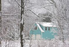beautiful aqua house in the snow