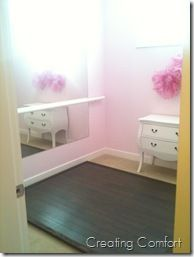 Ballet room. So cute. Complete with mirror, bar, and wood floors.