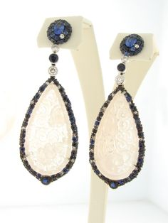 Entry 338  Robert Pelliccia  J.R. Dunn Jewelers  Lighthouse Point, FL  18K white gold dangle earrings featuring natural blue Jade accented with Sapphires (6.76 ctw.) and Diamonds (1.18 ctw.).
