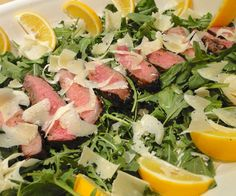 A simple salad of strips of grilled porter house steak, arugula, lemon and parmigiano reggiano. This traditional recipe is a simple answer to a summertime meal.