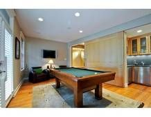 Lincoln Park home bar with pool table.