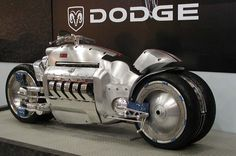 https://flic.kr/p/aEMLBy | Dodge Tomahawk motorcycle | The Tomahawk was a Dodge non-street legal concept vehicle introduced at the 2003 North American International Auto Show in Detroit, Michigan. It had futuristic and unusual design, featuring the 500 horsepower (370 kW) 8.3-litre (510 cu in) V10 SRT10 engine from the Dodge Viper. The vehicle has two front wheels and two rear wheels, making it a kind of motorized quadricycle rather than a typical motorcycle. The pairs of wheels move…