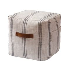 For extra seating in a living room use an easy-to-move soft ottoman that doubles as a footrest. French linen pouf, $59.97. Shop hometrends™ now at http://walmart.ca/hometrends | #walmart #hometrends