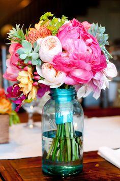 Love this, so very pretty. Makes me happy. colorful flowers, blue mason jars, centerpiec, color combos, flower bouquets, bride bouquets, wedding flowers, fresh flowers, bright colors