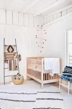 white and wood gender neutral nursery