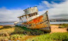 A old, shipwrecked boat on a sandbar in Inverness, Ca.  I wonder how many voyages this old ship took before arriving at its final resting place.  Love the colors!