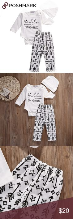 """Hello I'm New Here"" Tribal Neutral Baby Outfit Adorable 3 piece gender neutral outfit. Black and white tribal knit pants and matching ""hello, I'm new here"" bodysuit with white hat. Please note the sizing below as the outfit is a European size 70 about equal to a 6-9 month outfit.   Bodysuit- bust 9"" // length 14"" Pants- 6"" // length 15.5""  Hat (runs large) - 7"" at base, 5"" long Matching Sets"