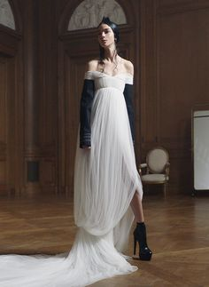 Ivory draped French tulle sarong gown with off-the-shoulder neckline and black wool felt sleeves with military corded cuffs