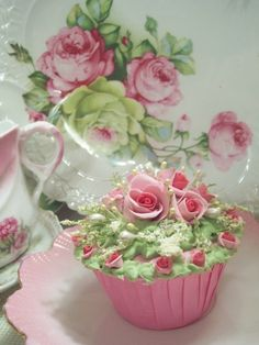 Beautiful china (pink roses) and gorgeous cupcake....I don't think I could make my self eat it....I'd want to prevserve it somehow, it's so pretty!  .