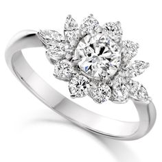 Cluster Diamond Engagement Ring with a large round brilliant cut diamond centre surrounded by Round Brilliant Cut Diamonds and MARQUISE Cut Diamonds. The Selection of Diamond Cuts in this Cluster gives it a more unique look. It is always nice to have something a little different!