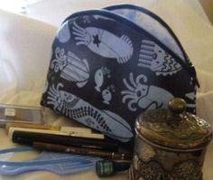 Tutorial for a zippered makeup bag - lined, quilted, two zippers, interior pocket, round top (tutorials posted over several days)
