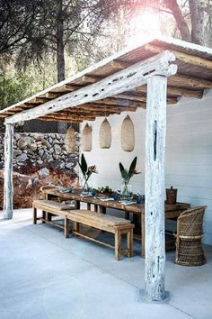 Classy and sophisticated pergola with wooden table and benches. For enhancing the appeal, have flowers on the table. Add unique looking lamps to bring a modern appeal. It is one of the best outdoor room pergola design ideas because of simplicity. Diy Pergola, Pergola Ideas, Patio Ideas, Patio Bohemio, Modern Spanish Decor, Backyard Storage Sheds, Bohemian Patio, Outdoor Furniture Design, Backyard Garden Design