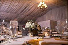 This couple added some country charm to their Chicago wedding at the Eaglewood Resort and Spa. The brides beautiful lace ball gown and cowgirl boots looked picturesque at St. Isidore Parish. Their rustic style was a big part of the night with burlap table runners, wooden centerpiece boxes and mason jars! This couple created such a memorable night. Photos by Jorge Medina Photography