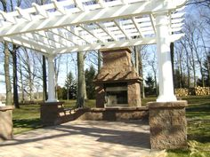 Pair your outdoor fireplace with a pergola and create an amazing outdoor living space!