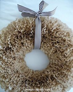 Coffee filter wreath. Need wreath base, 200 coffee filters, ribbon, hot glue gun, and band aid.