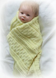 The Little Acorns' Blanket is technically a baby blanket for use when out and about with that precious new little life - but was also  designed with the intention that it be enjoyed well into adulthood, providing warmth and comfort whenever and wherever it is needed.   It would make a great knee rug when sitting in front of the TV,