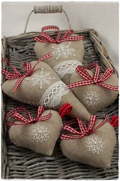 linen hearts with cross stitched snowflakes