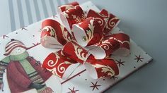Photos of christmas present wrapping bows | Make your own gift wrap bows out of leftover wrapping paper.