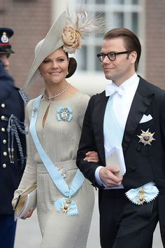 Crown Princess Victoria of Sweden and her fabulous hat with husband Prince Daniel at the investiture in Amsterdam. 4/30/2013
