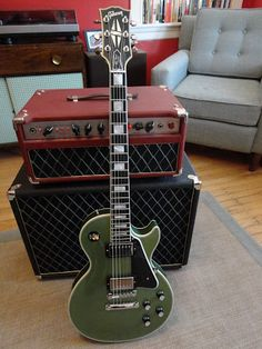 1968 Les Paul Custom guitar with vintage amp and head. RESEARCH #DdO:) - http://www.pinterest.com/DianaDeeOsborne/ddo-most-popular-re-pins/ - MOST POPULAR RE-PINS board. This solid body electric guitar built only 16 years after the first one sold by Gibson Guitar Corporation in 1952. On #cSw's  guitar and amps #Pinterest board - see http://www.pinterest.com/claxtonw/4-5-6-strings -  4 5 6 STRINGS, with many other musical instruments; or BASS FOUNDATION board. Photo Source: The Gear Page