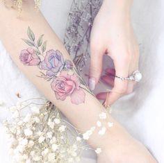 Roses on forearm by Mini Lau