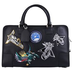 Kelly Connor, Vogue.com Market Editor - Like a great pair of jeans, patches only make a bag better! This Loewe bag is practical but not too serious, which, to me, makes for a perfect investment. Loewe Techno Chrome Amazona 44 bag, $2,310, for information: elitestore.es