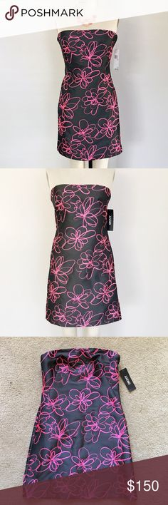DKNY black pink strapless floral dress- size 6 Original price $295 plus tax. Very simple but elegant strapless dress from DKNY- Donna Karan New York.  Perfect for date night/ night out and formal occasions.  Strapless. Hidden two small pockets on both sides. Back sip closure. Fully lined. 100% polyester. Made in Italy. Size 6- Bust 35 , Waist 27.5, Hips 38  P/s: necklace is for display only, not for sale. DKNY Dresses Strapless