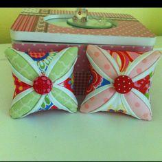 My sister's handmade pin cushions. Adorable!!