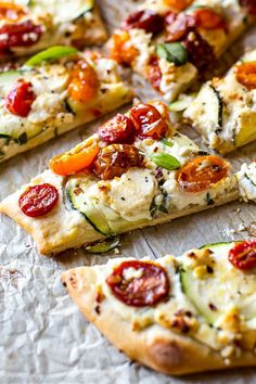 Easy homemade flatbread pizza topped with summery zucchini, herbed ricotta, roasted tomatoes, and fresh basil. So much flavor! Recipe on http://sallysbakingaddiction.com