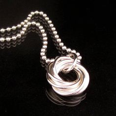 Sterling Silver Chainmaille Rosette Pendant. $26.00, via Etsy.