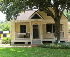 warm yellow house paint with white trim