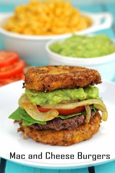 """Mac and Cheese Burgers with Guacamole and Grilled Onions from The Stay At Home Chef. The """"buns"""" are made out of fried mac and cheese! How can this not just be outrageously delicious?"""