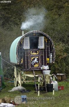 The traditional Romany gypsy caravans of the Hoare family as they live off the land in rural Hampshire . They claim to take nothing from the State and to keep to the traditional Romany values . stock photo