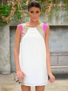 Love the minimalistic white dress with neon pink and gold accents