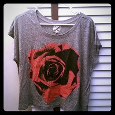 Graphic Rose Tee Super comfy, loose fitted tee with rose design in front.  Cotton/polyester blend. Bought from Urban Outfitters, never worn! Urban Outfitters Tops Tees - Short Sleeve