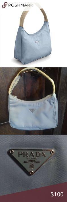 "PRADA HANDBAG MV519 (PERVINCA) EVENING BAG NEW SMALL STAIN IN 3RD PHOTO but never worn or used.  💎. PRADA HANDBAG MV519 (PERVINCA) EVENING BAG NEW  Prada MV519 Blue Pervinca Beige tessuto nylon fabric Dimensions 8"" x 5"" x 2.5""! 12"" fabric strap. Made in Italy  Regular price: $250.00 Sale price: $185 Prada Bags"