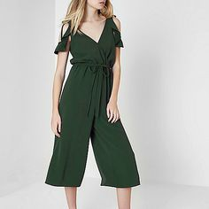 Woven fabric Wrap style Cold shoulder with tie detail Short frill sleeve Tie waist Cropped wide leg Our model wears a UK 8 and is 175cm/5'9'' tall