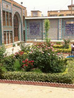 Flower garden courtyard of Takieh Moaven 'ol Malek in Kermanshah City, Iran.