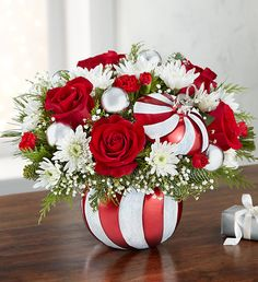 EXCLUSIVE All the sweetness of the holiday is captured in our new, limited edition arrangement. Joyful red & white blooms are gathered with festive silver ball ornaments and arranged inside our peppermint candy container. 800 Flowers, Types Of Flowers, Fresh Flowers, White Flowers, Rose Delivery, Flower Delivery, Christmas Floral Arrangements, Flower Arrangements, Christmas Flowers